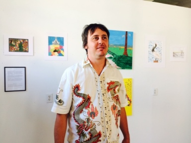 Isleton artist David Young, a New Orleans native, stands in front of some of his artwork before the opening Saturday.