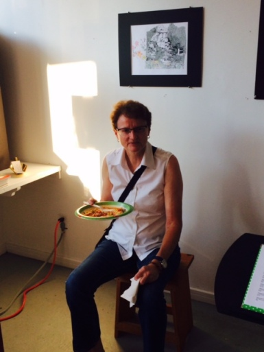 Kim Robertson of Locke, formerly of New Zealand, polishes off jambalaya as she decides on her purchase at the opening.