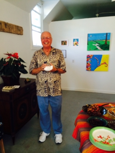 Mike, a summer visitor to Isleton, purchased artwork at the opening.