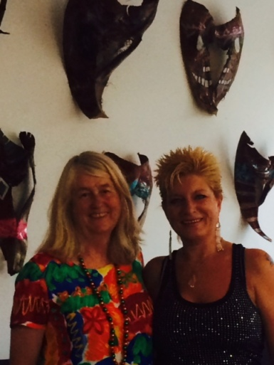 Sam Wood (right), Isleton artist, fashioned exotic palm masks for Saturday's opening at F and Main Gallery.