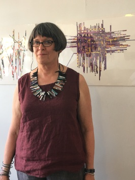 Collage artist Christina Creveling explains her process at the opening of her show at F and Main Gallery Sept. 25. The show runs through Nov. 13.