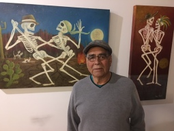 Gary F. Duarte with his paintings